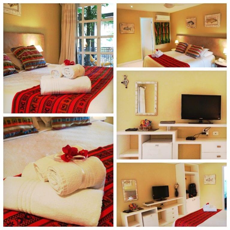 Aquabarra Boutique Hotel & Spa - nosso quarto com uma cama grande e um arranjo fofo de toalhas