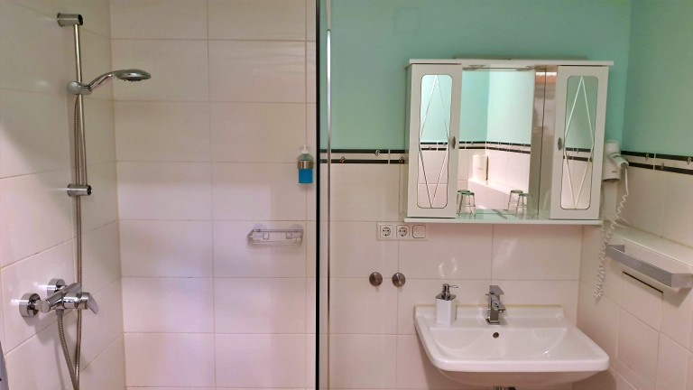 Banheiro do Kreuzerhof Hotel Garni